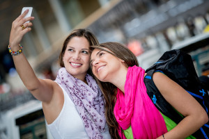 Happy SBN passengers taking a selfie at South Bend Airport