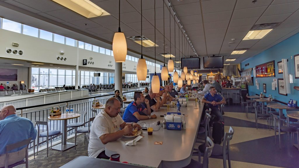 diners eat in airport restaurant
