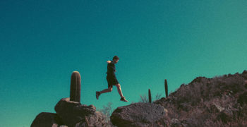 Person jumping between rocks in the desert near Phoenix