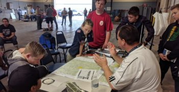 Airport tenant and boy scout looking at a map