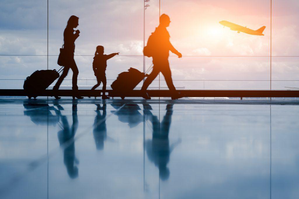 Family walks through the terminal